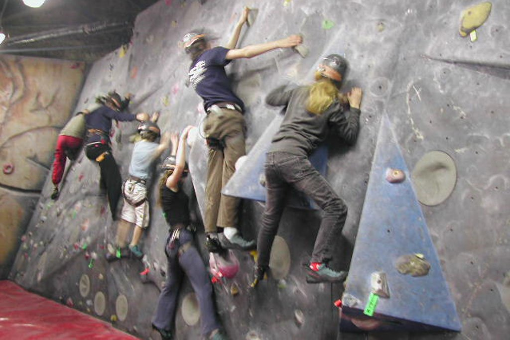 Young people bouldering on the slabs