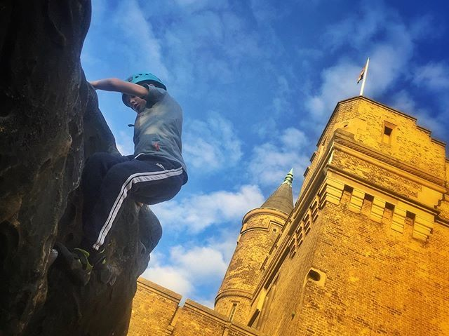 Climbing on the outdoor boulders at The Castle